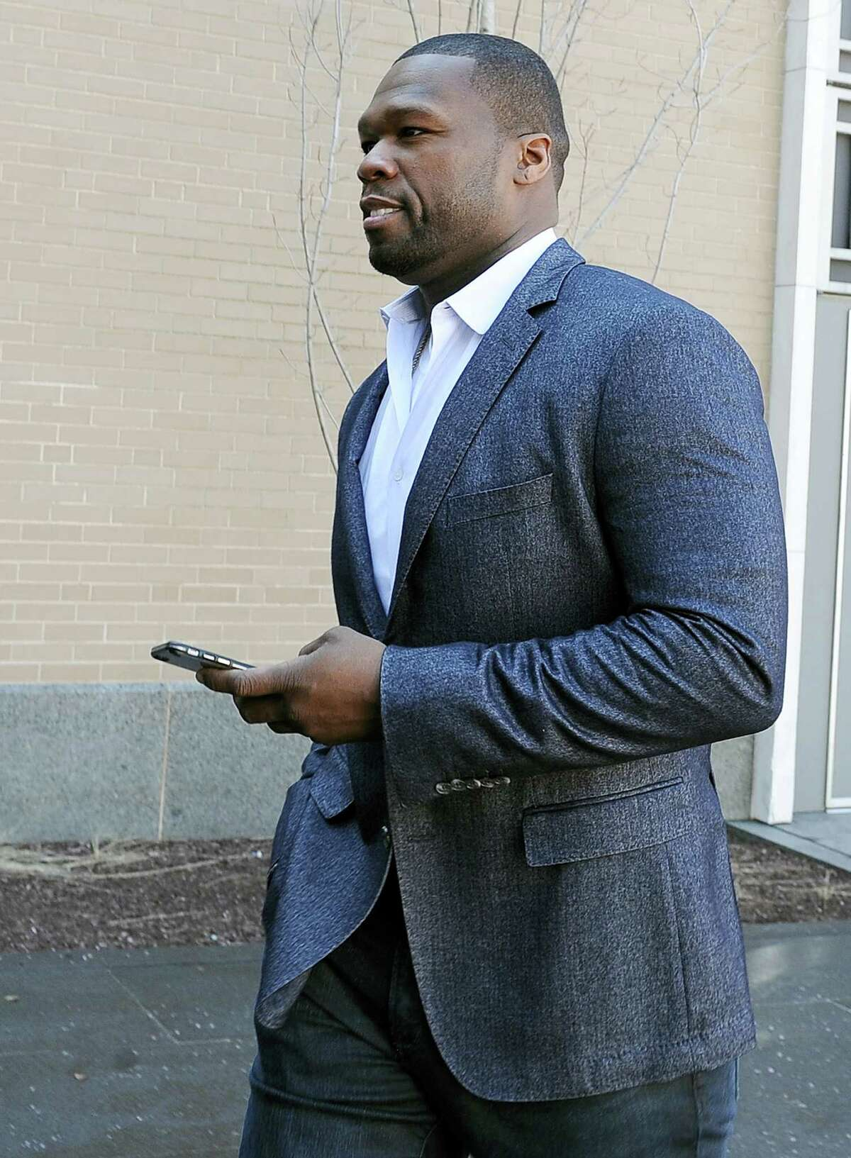 """Curtis """"50 Cent"""" Jackson arrives at court for a federal bankruptcy hearing, Wednesday, March 9, 2016, in Hartford. Jackson has been ordered to explain Instagram photos, with one depicting him next to piles of cash arranged to spell out """"broke."""" Jackson filed for bankruptcy last year after a New York City jury ordered him to pay $7 million to a woman who said he posted her sex tape online."""