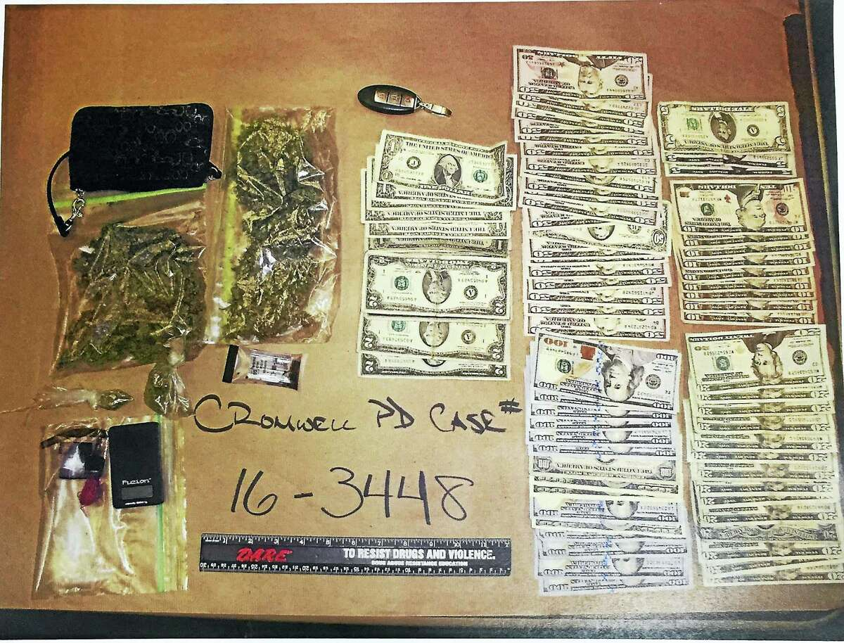 Authorities say a 29-year-old Country Squire Drive woman was arrested over the weekend after they found almost $3,000 in cash and over two ounces of marijuana in her possession.