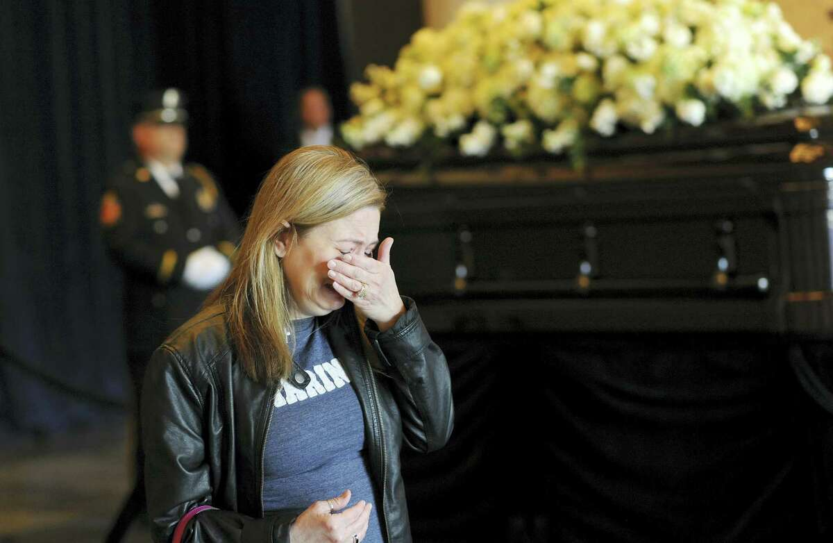 Kimberly Leif, of Simi Valley, Calif., cries in front of the casket of Nancy Reagan at the Ronald Reagan Presidential Library in Simi Valley on Wednesday, March 9, 2016. Reagan began her final journey to her husband's side Wednesday as a police motorcade carried her casket down an empty freeway lined with saluting firefighters and mourners holding hands over their hearts in tribute to the former first lady.