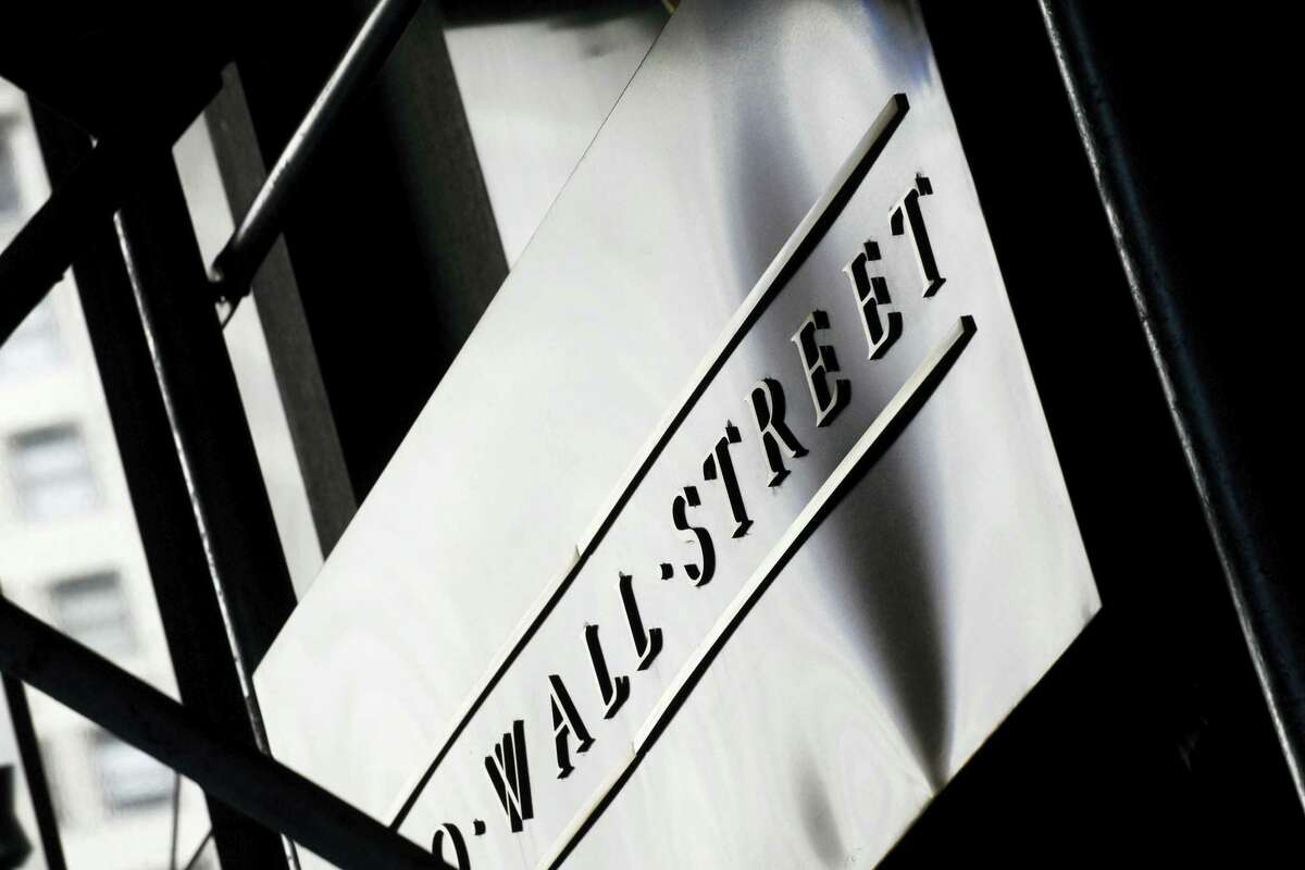 A sign for Wall Street outside the New York Stock Exchange.