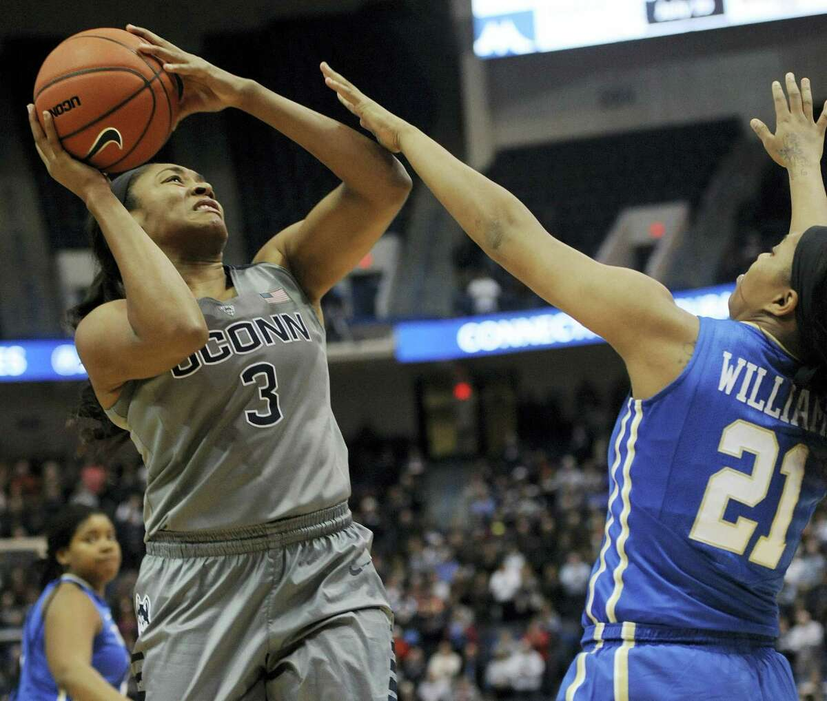 Connecticut's Morgan Tuck, left, is fouled by Tulsa's Te'era Williams in the first half of an NCAA college basketball game, Wednesday, Jan. 6, 2016, in Hartford, Conn. (AP Photo/Jessica Hill)