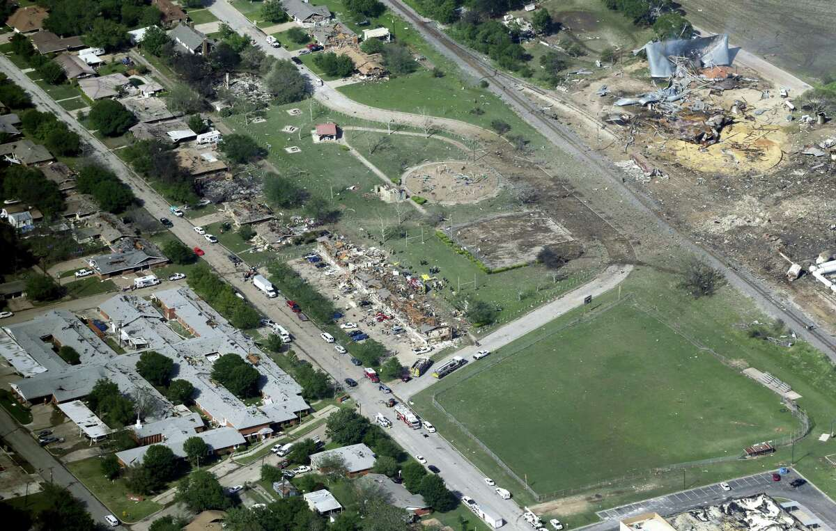 This April 18, 2013 aerial file photo shows the remains of a nursing home, left, apartment complex, center, and fertilizer plant, right, destroyed by an explosion at a fertilizer plant in West, Texas. Federal authorities announced Wednesday, May 11, 2016, that the fire that caused the deadly explosion in 2013 was a criminal act. The explosion killed 15 people, injured hundreds and left part of the small town in ruins.