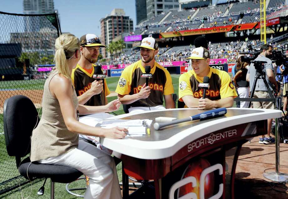 Anthony Rizzo, right, Kris Bryant, center, and Ben Zobrist, all of the Chicago Cubs, are interviewed prior to Monday's Home Run Derby. Photo: Lenny Ignelzi — The Associated Press  / AP