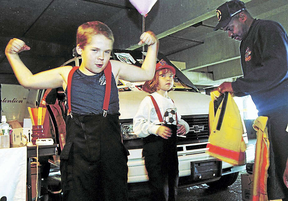 Eddie Peterson, 10, of Middletown flexes his muscles after trying on a pair of firefighter's suspenders at the Kid's Health and Safety Fair on Dingwall Drive in Middletown in this file photo. Photo: File Photo