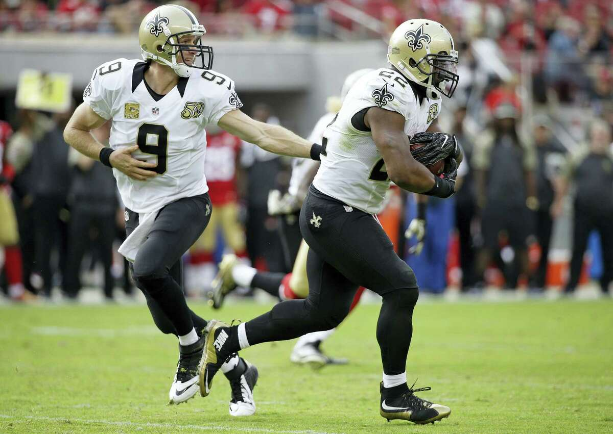 New Orleans Saints quarterback Drew Brees, left, hands off the ball to New Orleans Saints running back Mark Ingram, right, who rushes with the ball for a 75-yard touchdown during the first half of an NFL football game against the San Francisco 49ers Nov. 6, 2016 in Santa Clara, Calif.