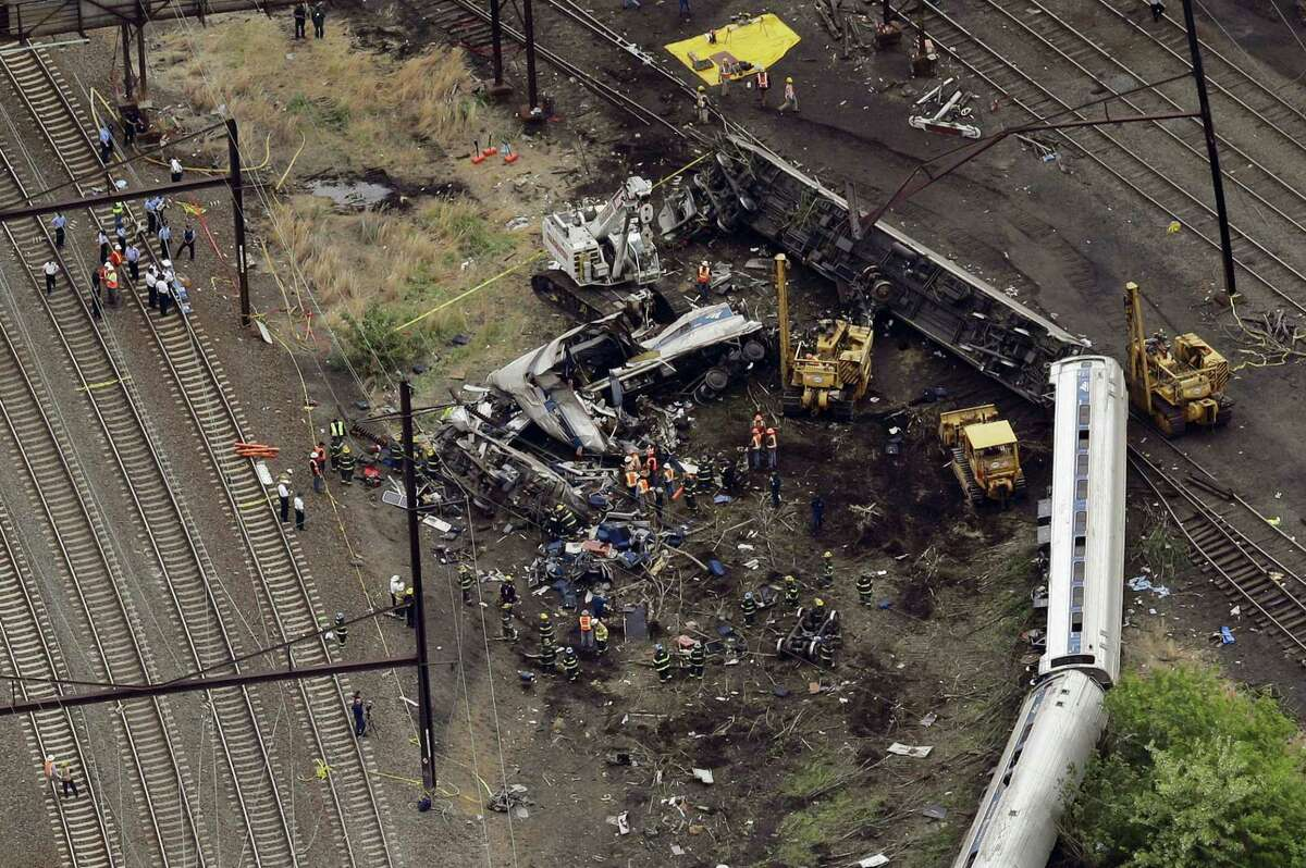 Emergency personnel work at the scene a day after the deadly train wreck in Philadelphia.