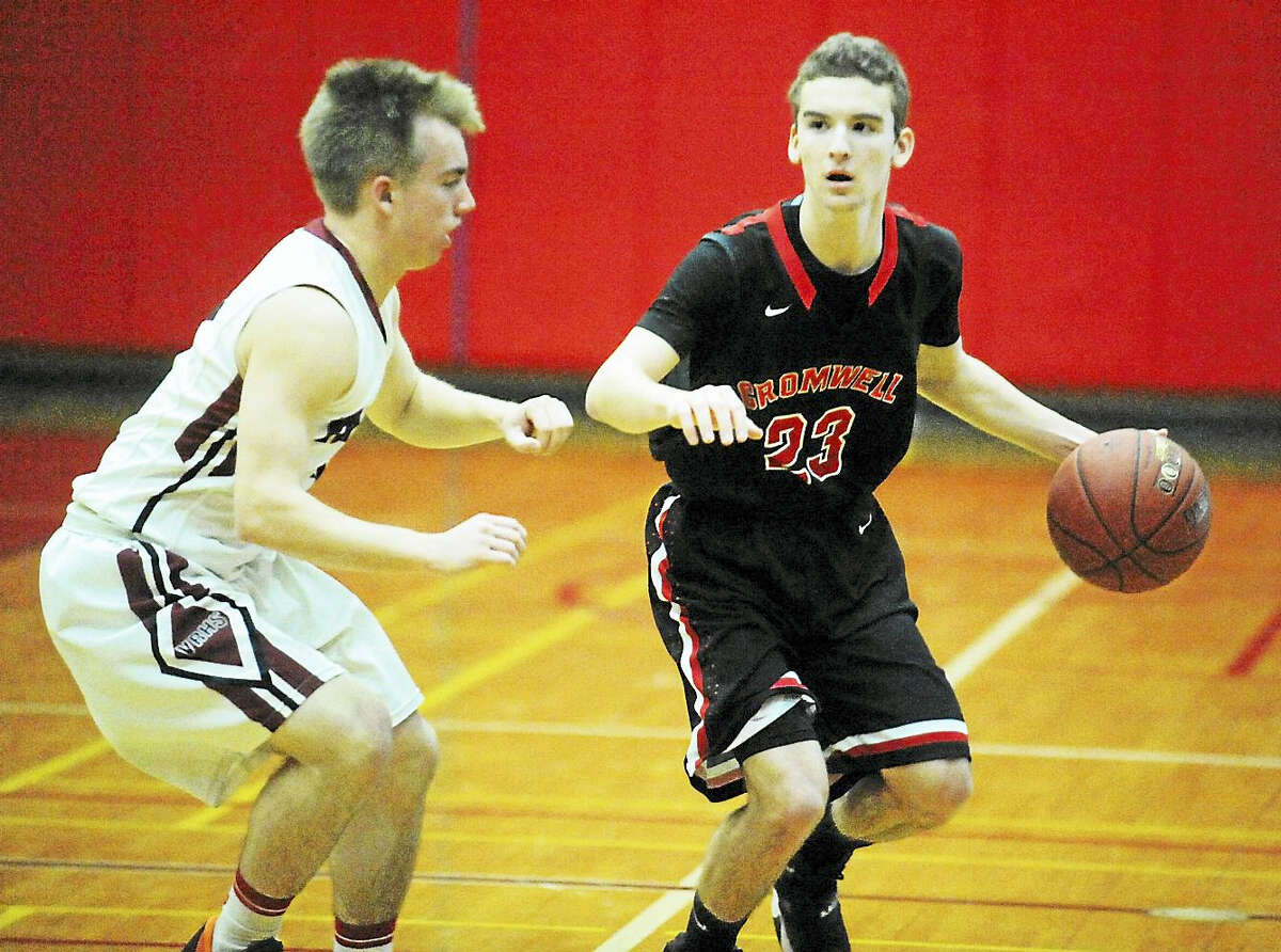 Cromwell senior Peter Dewey makes his move against Valley Regional senior Garrett Hines in the Panthers 52-36 win Tuesday at Deep River.
