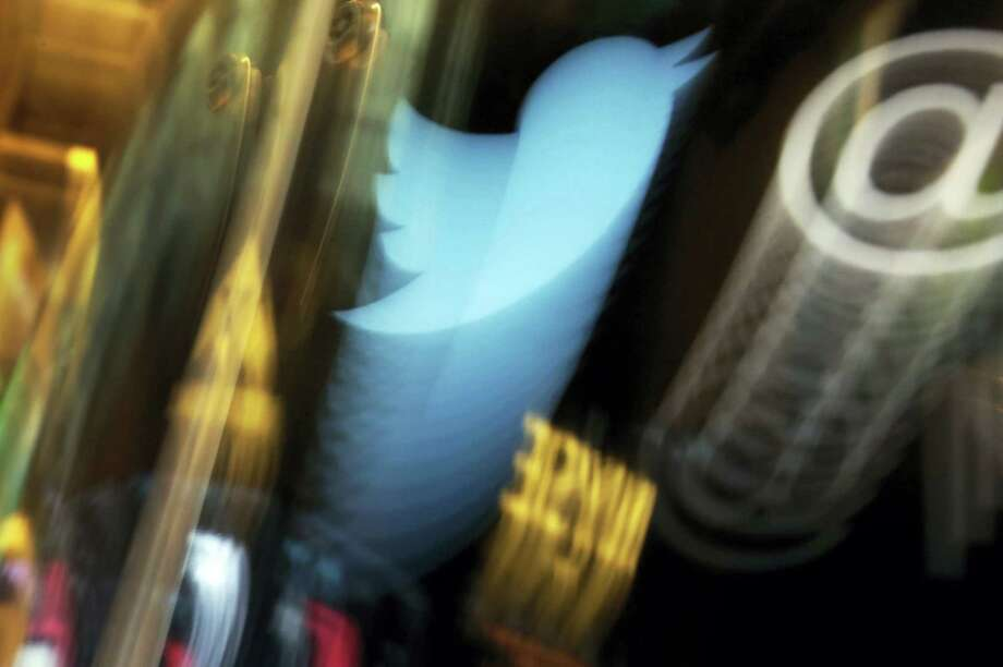 In this Wednesday file photo, the Twitter logo appears on an updated phone post on the floor of the New York Stock Exchange. Photo: Richard Drew — The Associated Press File  / AP2013