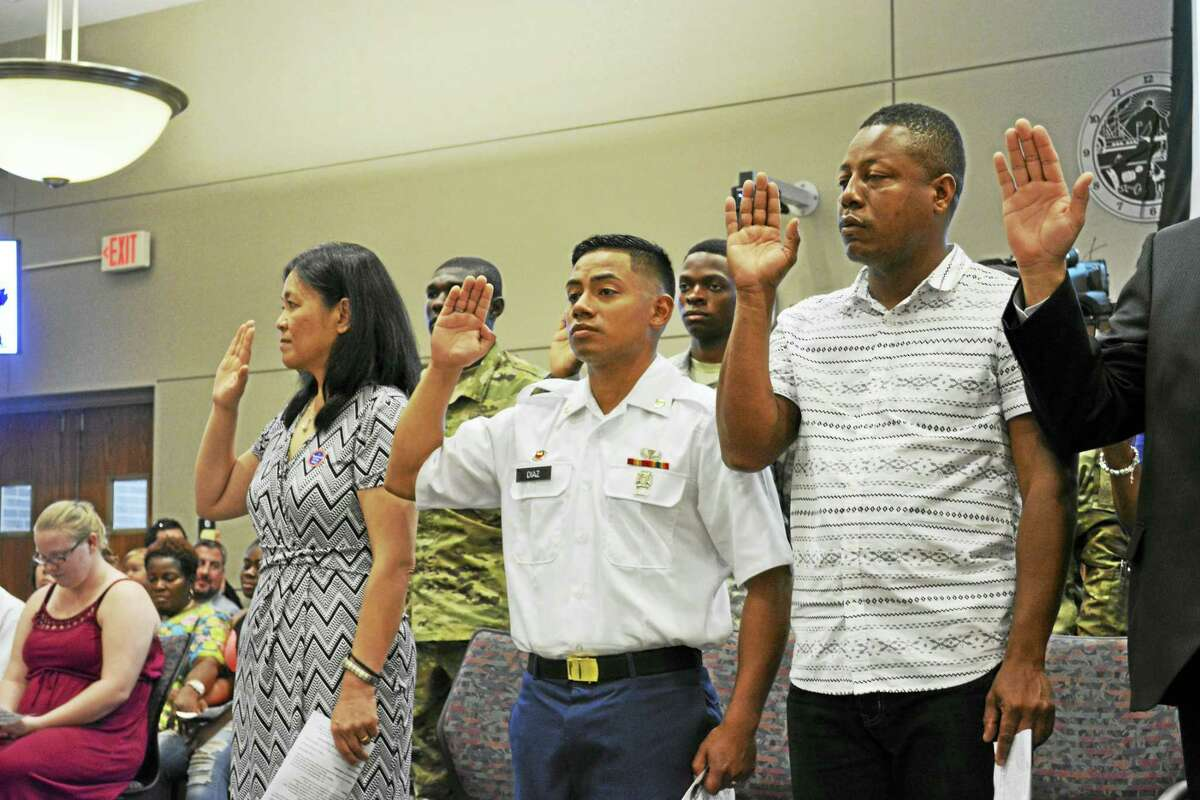 """By taking the country's oath of allegiance, new U.S. citizens agree to """"support and defend the Constitution,"""" and to serve the country, in the military or as a civilian, when required by law."""