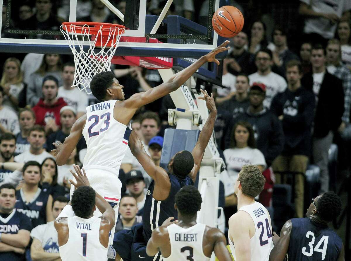 UConn's Juwan Durham blocks a shot attempt by Southern Connecticut's Michael Mallory in the second half of an exhibition NCAA college basketball game, Saturday. The Huskies host Wagner in their regular-season opener Friday at Gampel Pavilion.