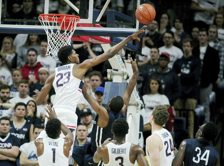 UConn's Juwan Durham  blocks a shot attempt by Southern Connecticut's Michael Mallory in the second half of an exhibition NCAA college basketball game, Saturday. The Huskies host Wagner in their regular-season opener Friday at Gampel Pavilion. Photo: JESSICA HILL — The Associated Press  / AP2016