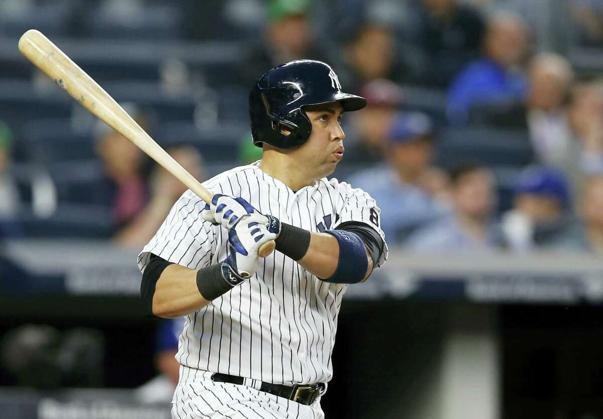 New York Yankees Carlos Beltran reacts as he watches his third-inning, solo, home run off Kansas City Royals starting pitcher Chris Young in a baseball game at Yankee Stadium in New York Monday.