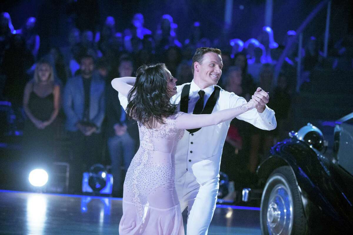 """In this photo provided by ABC, Cheryl Burke, left, and Ryan Lochte, perform on """"Dancing with the Stars,"""" competition that begins with the two-hour season premiere live Sept. 12, 2016 on the ABC Television Network."""