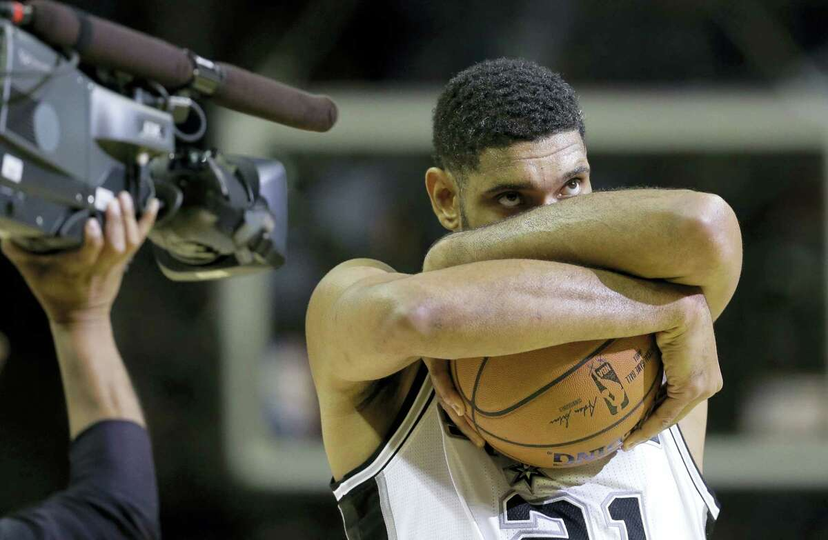 In this Oct. 28, 2014 photo, San Antonio Spurs' Tim Duncan prepares for an NBA basketball game against the Dallas Mavericks,in San Antonio. Duncan announced his retirement on Monday, July 11, 2016 after 19 seasons, five championships, two MVP awards and 15 All-Star appearances. It marks the end of an era for the Spurs and the NBA.