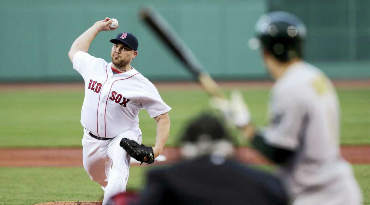 CHARLES KRUPA — THE ASSOCIATED PRESS Boston Red Sox starting pitcher Sean O'Sullivan delivers during the first inning of the Red Sox' 13-5 win over the Oakland Athletics Tuesday.
