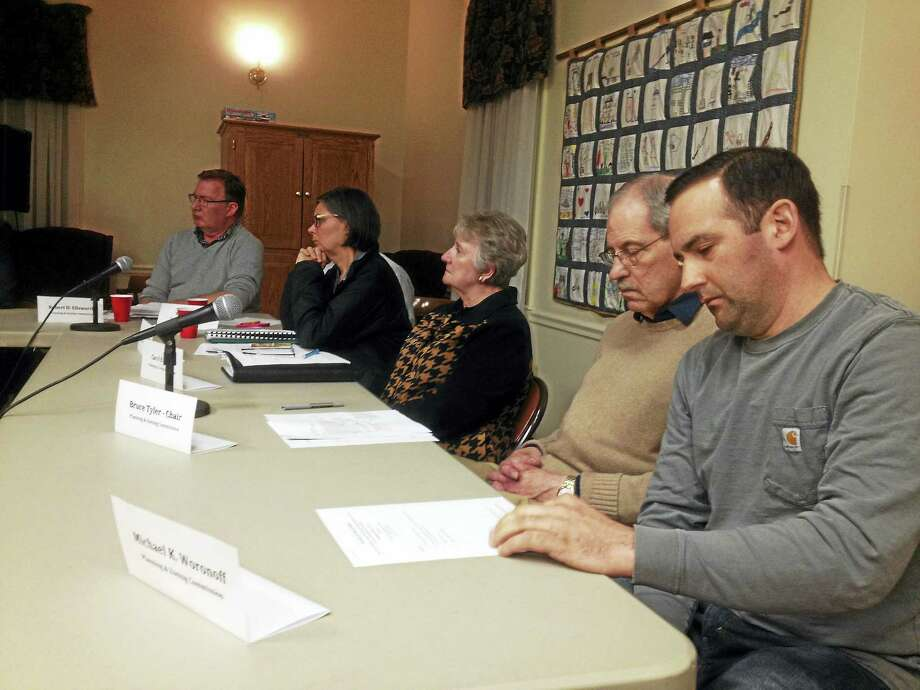 Nearly 80 residents attended a three-board joint meeting to hear about a developer's plan to build a residential and commercial complex on the former Elmcrest property Wednesday evening in Portland. Photo: Jeff Mill — The Middletown Press