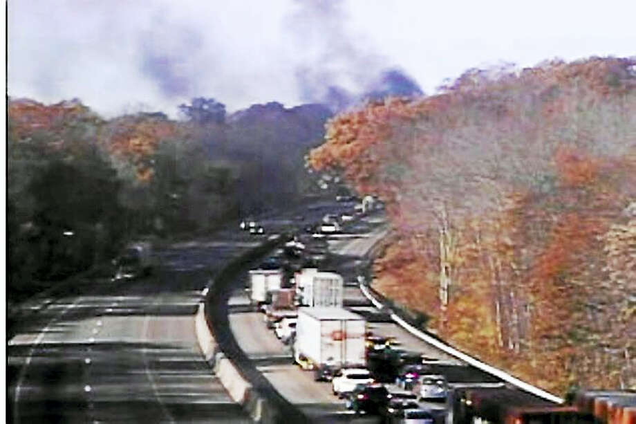 Part of Intersate 95 south was shut down in Clinton late Thursday morning for a tractor-trailer fire. The blaze, between exits 64 and 63, sent black smoke billowing into the air. Photo: Courtesy Department Of Transportation
