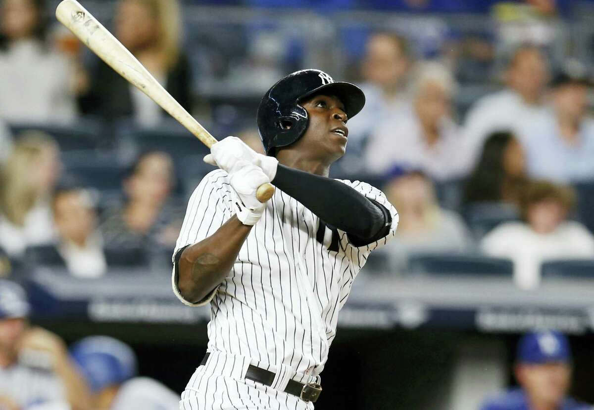 New York pinch-hitter Didi Gregorius watches his seventh-inning solo home run against the Los Angeles Dodgers.