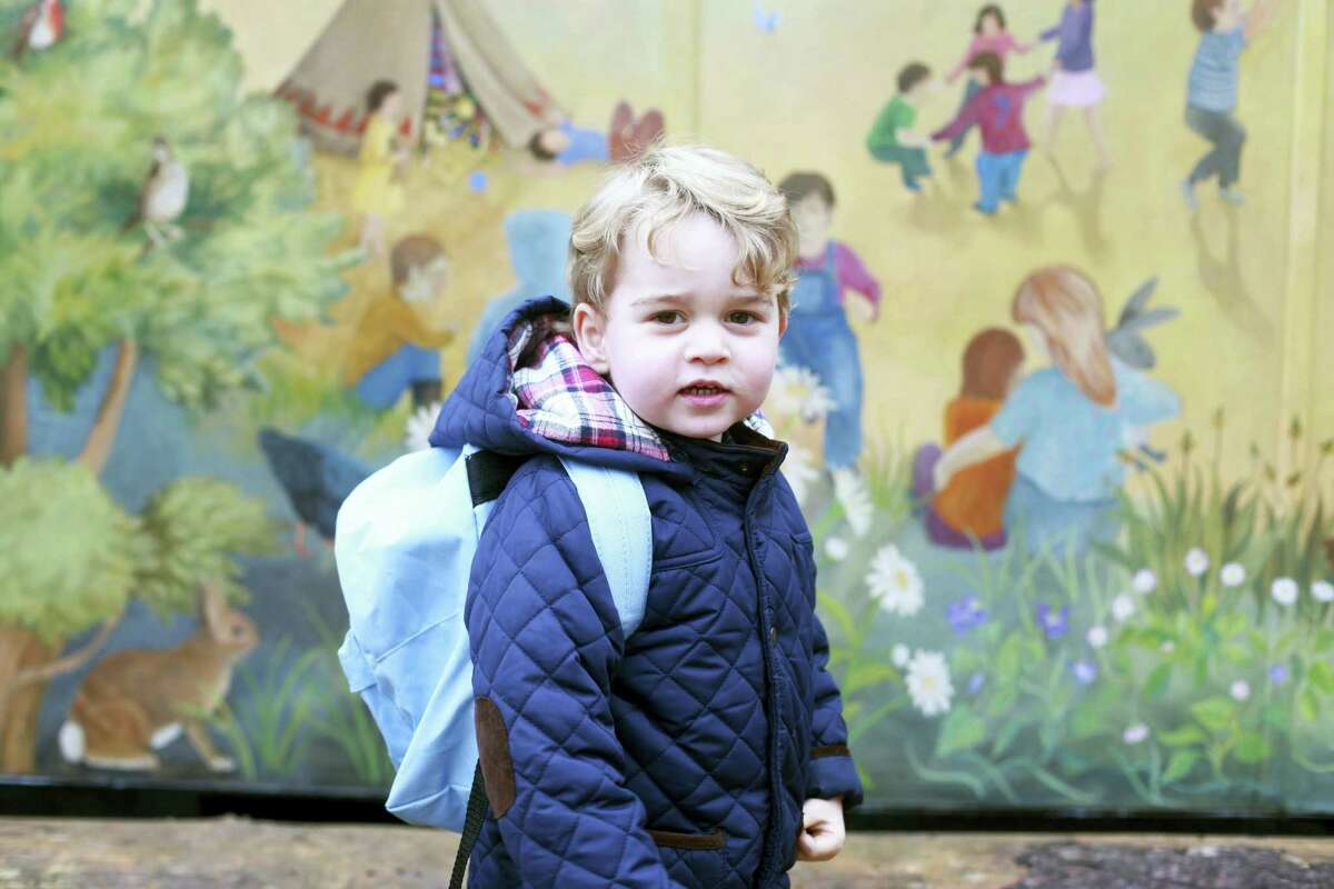 In this handout photograph provided by Kensington Palace on Wednesday, Jan. 6, 2016, and taken by Kate, The Duchess of Cambridge, Britain's Prince George poses on his first day at the Westacre Montessori nursery school near Sandringham in Norfolk, England.