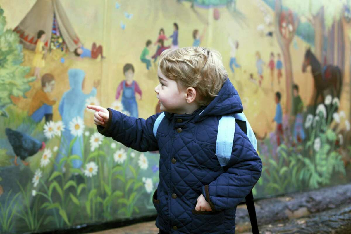 The Duchess of Cambridge/Kensington Palace via AP In this handout photograph provided by Kensington Palace on Wednesday, Jan. 6, 2016, and taken by Kate, The Duchess of Cambridge, Britain's Prince George poses on his first day at the Westacre Montessori nursery school near Sandringham in Norfolk, England.