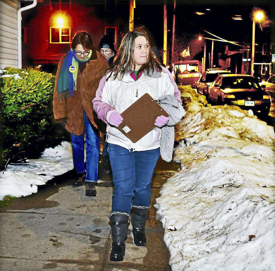 Team leader Veronica Cruz walks on Lloyd Street in the Fair Haven section of New Haven looking for homeless people during the 2016 Point in Time Homeless Count. Photo: Catherine Avalone — New Haven Register  / New Haven RegisterThe Middletown Press