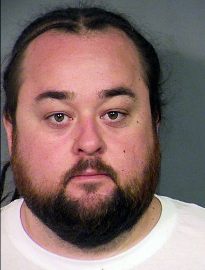 "This Clark County Detention Center photo, provided by the Las Vegas Metropolitan Police Department, shows Austin Lee Russell, 33, of Las Vegas, on Wednesday, March 9, 2016. Russell is known as Chumlee to viewers of the reality cable TV show ""Pawn Stars."" Russell was being held in a Las Vegas jail late Wednesday, following his arrest on weapon and multiple drug charges, after officers serving a warrant at his home in a sexual assault investigation found methamphetamine, marijuana and at least one gun. Photo: Las Vegas Metropolitan Police Department Via AP / Las Vegas Metropolitan Police Department"