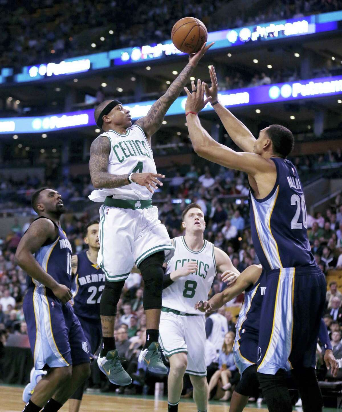 Boston Celtics guard Isaiah Thomas (4) drives to the basket against the Memphis Grizzlies during the first quarter Wednesday in Boston. Thomas scored 22 points in the Celtics 116-96 win.