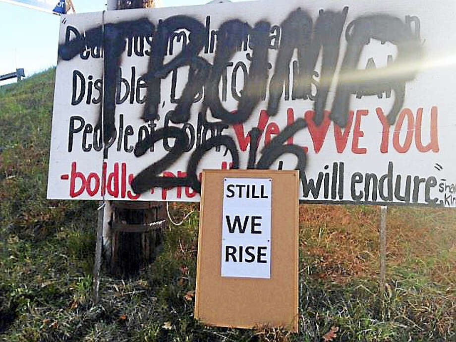 Theresa Govert put up a sign along Route 149 in the Moodus section of East Haddam home after the election of Donald Trump. The next day, someone had painted over it in big black letters. Photo: Courtesy Theresa Govert