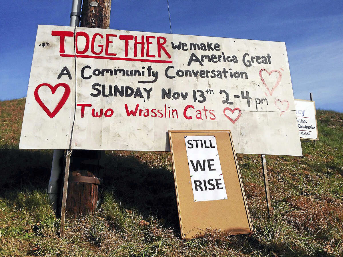 """Now the billboard at the corner that says """"Together we make America great"""" advertises a community conversation organized for Sunday in East Haddam."""
