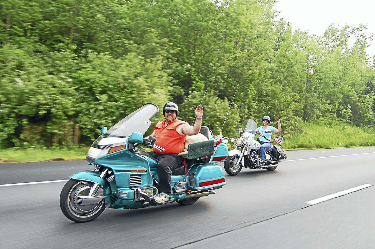Dave Taylor, founder and president of Liberated Riders, a motorcycle ministry, is organizing a ride to benefit the Day of Joy Thanksgiving benefit organized by His Divine Fellowship Ministries. Taylor is pictured here riding with his wife, Linda Taylor.