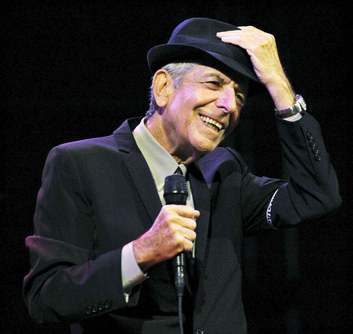 """In this April 17, 2009, file photo, Leonard Cohen performs during the first day of the Coachella Valley Music & Arts Festival in Indio, Calif. Cohen, the gravelly-voiced Canadian singer-songwriter of hits like """"Hallelujah,"""" """"Suzanne"""" and """"Bird on a Wire,"""" has died, his management said in a statement Thursday, Nov. 9, 2016. He was 82."""