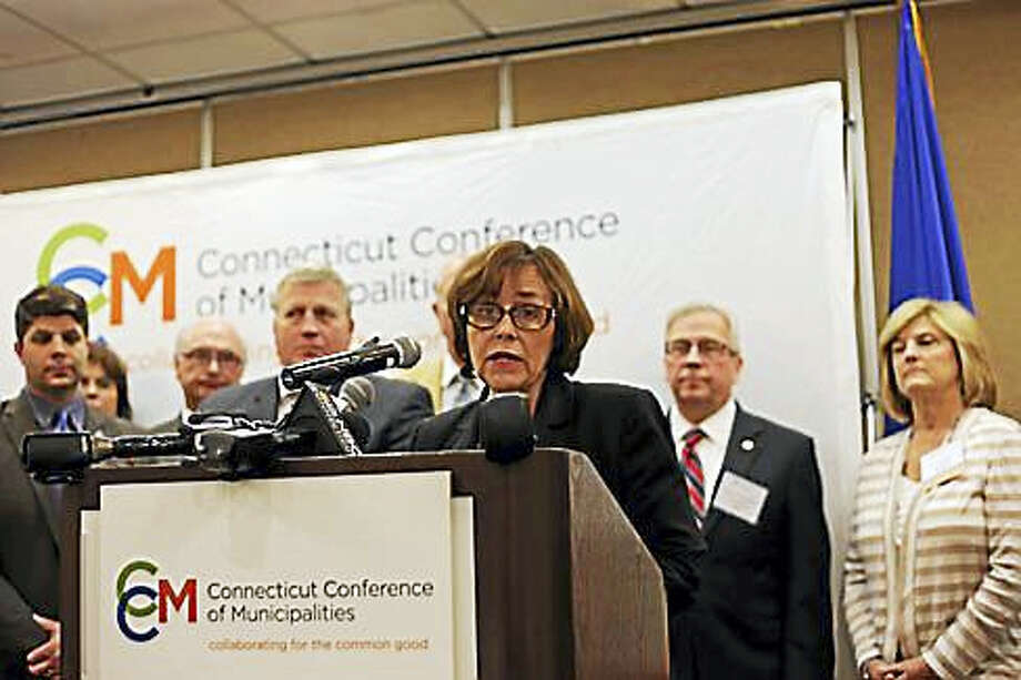 CHRISTINE STUART PHOTO Portland First Selectwoman Susan Bransfield, vice president of the Connecticut Conference of Municipalities, speaks during a press conference in Cromwell Tuesday. At far left is Middletown Mayor Dan Drew. Photo: Journal Register Co.
