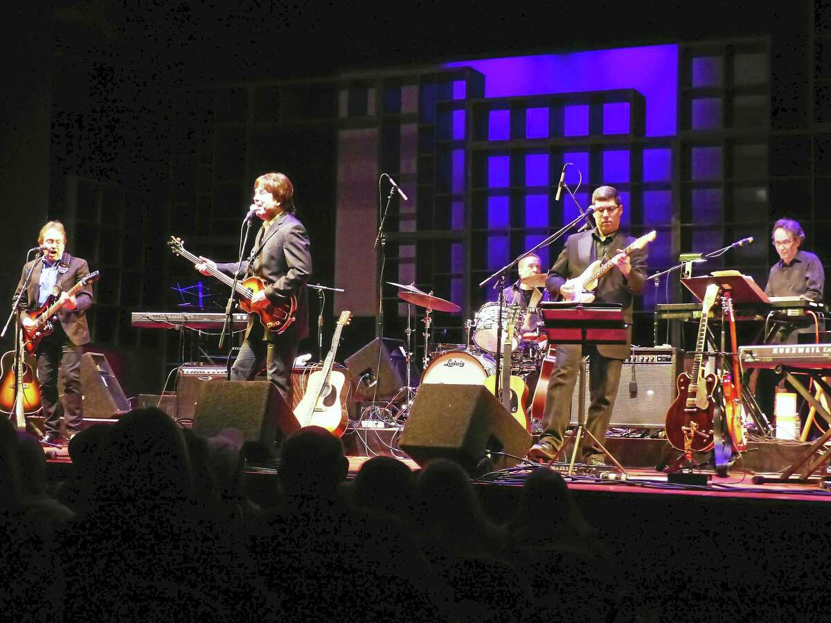 Lenie Colacino, second from left, as Paul in the McCartney tribute band.