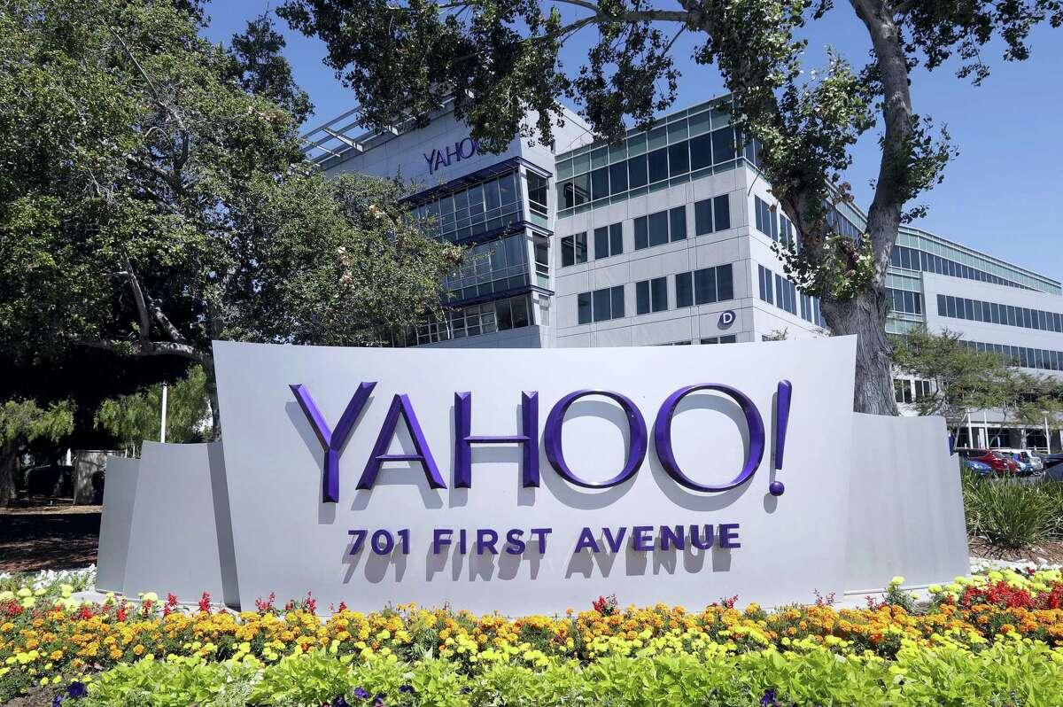 In this file photo, flowers bloom in front of a Yahoo sign at the company's headquarters in Sunnyvale.
