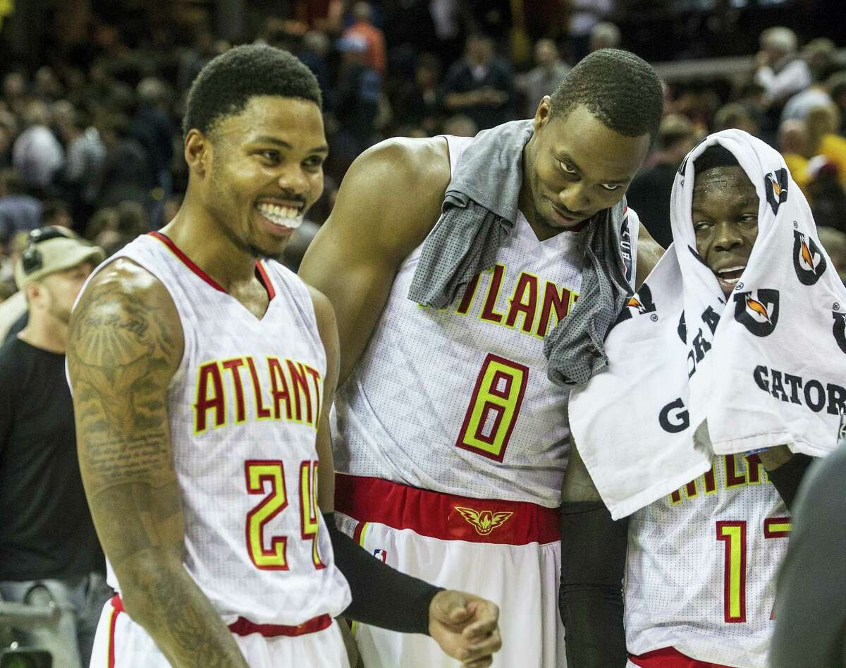 Atlanta Hawks' Kent Bazemore (24), Dwight Howard (8), and Dennis Schroder, right, fool around after defeating the Cleveland Cavaliers in an NBA basketball game in Cleveland on Tuesday, Nov. 8, 2016.
