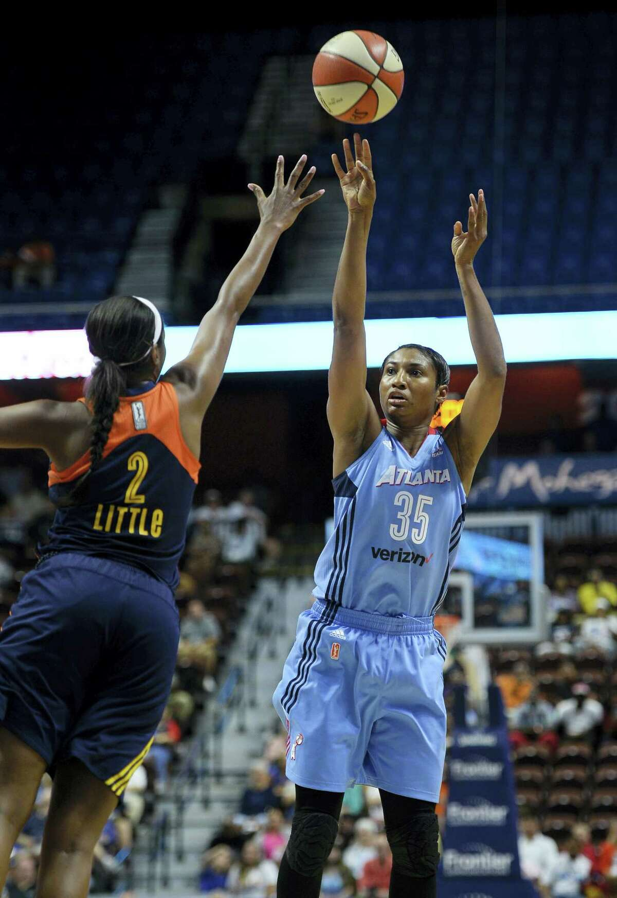 The Dream's Angel McCoughtry, right, shoots over the Sun's Camille Little on Saturday.