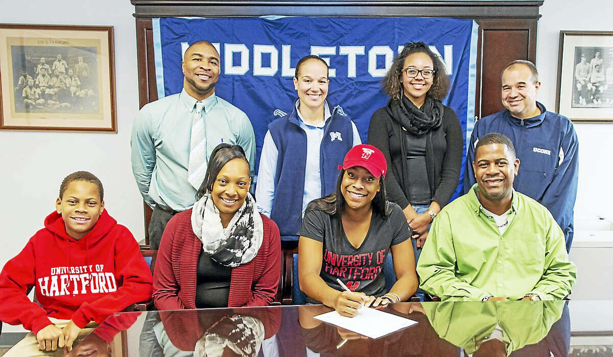 Middletown senior Brielle Wilborn signs her letter of intent to play basketball at the University of Hartford. Joining Brielle are, her brother, Elijah, mother Lukanya, and father, Dean Wilborn. Second row, from left, AAU coach Donta Johnson, MHS Director of Athletics Elisha De Jesus, and MHS girls' basketball coach Rob Smernoff.