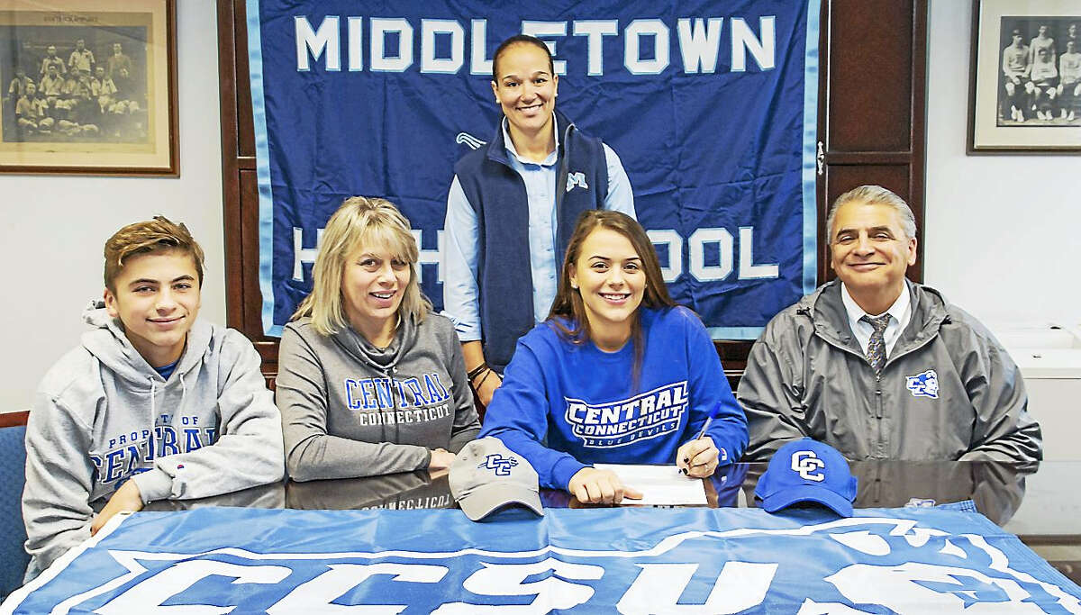Middletown senior Samantha Pizzonia signs her letter of intent to play softball at Central Connecticut State University. Joining Samantha are her brother Greyson, mother Linda, her father, Rick Pizzonia, and MHS Director of Athletics Elisha De Jesus.