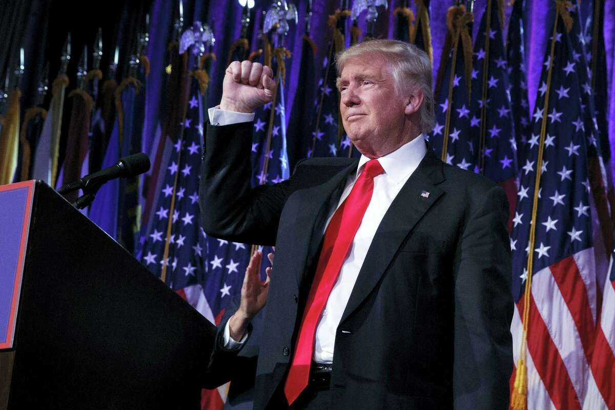 President-elect Donald Trump pumps his fist during an election night rally on Wednesday, Nov. 9, 2016 in New York.