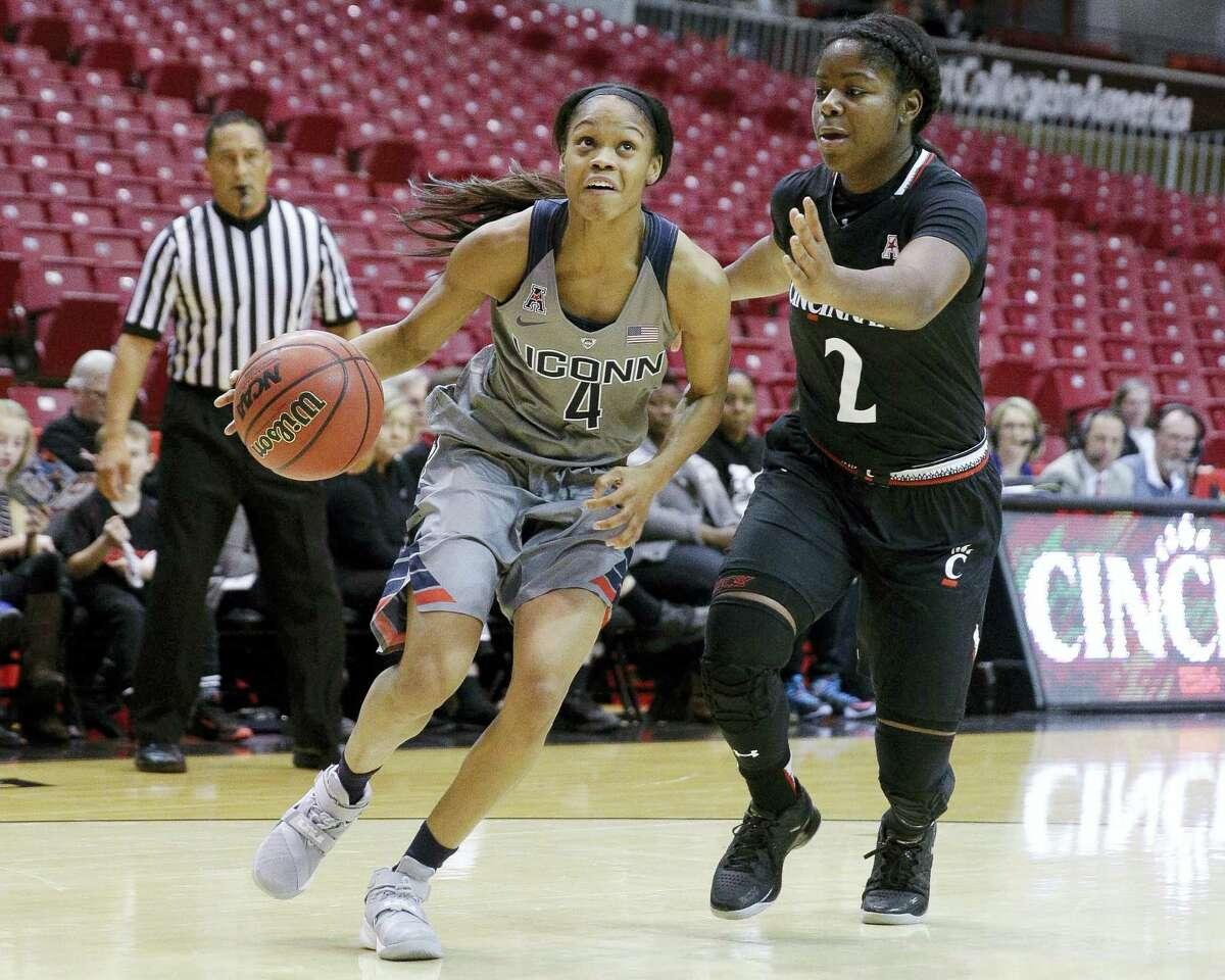 Connecticut's Moriah Jefferson (4) drives around Cincinnati's Nikira Goings (2) in the first half of an NCAA college basketball game, Wednesday, Dec. 30, 2015, in Cincinnati. Connecticut won 107-45. (AP Photo/John Minchillo)