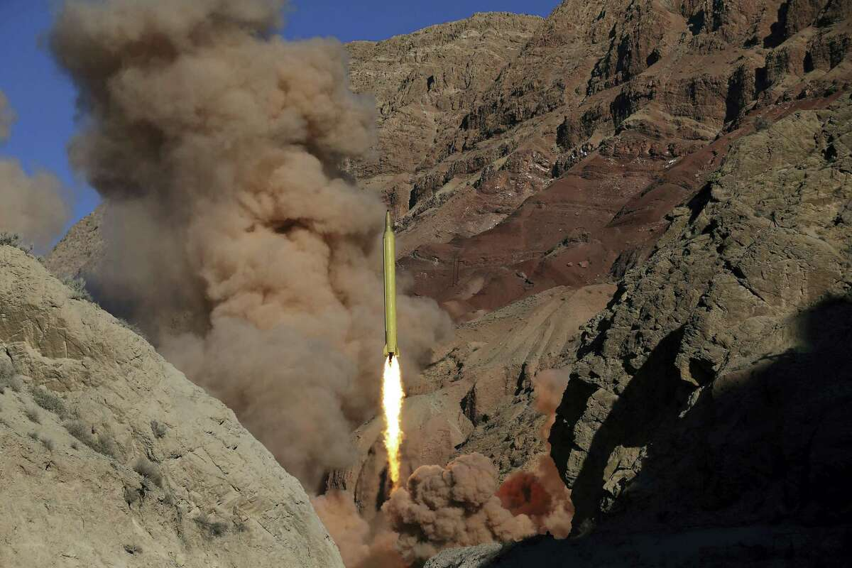 """In this photo obtained from the Iranian Fars News Agency, a Qadr H long-range ballistic surface-to-surface missile is fired by Iran's powerful Revolutionary Guard, during a maneuver, in an undisclosed location in Iran, Wednesday, March 9, 2016. Iran's powerful Revolutionary Guard test-fired two ballistic missiles Wednesday with the phrase """"Israel must be wiped out"""" written on them, a show of deterrence power by the Islamic Republic as U.S. Vice President Joe Biden visited Israel, the semi-official Fars news agency reported."""