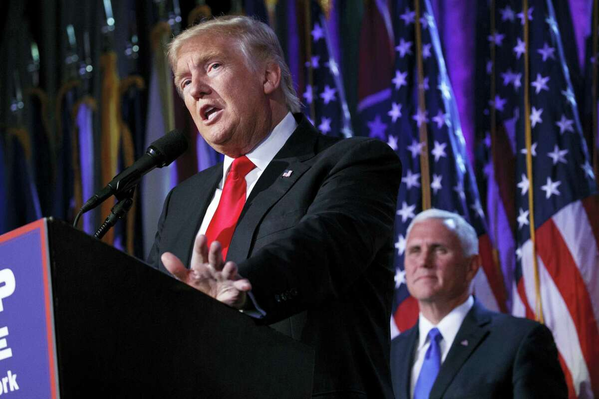Vice president-elect Mike Pence, right, watches as President-elect Donald Trump speaks during an election night rally on Wednesday, Nov. 9, 2016 in New York.