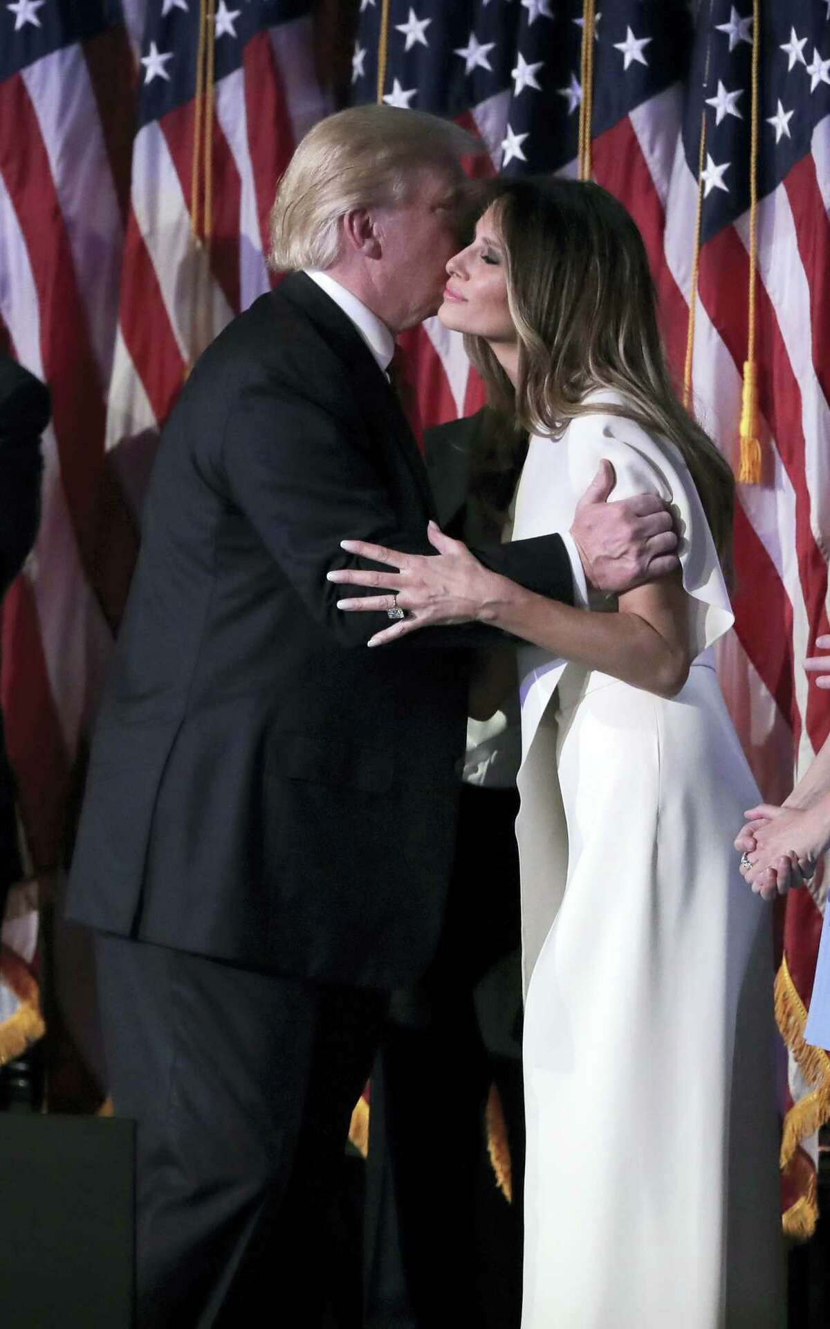President-elect Donald Trump kisses his wife Melania Trump after giving his acceptance speech during his election night rally Wednesday, Nov. 9, 2016 in New York.