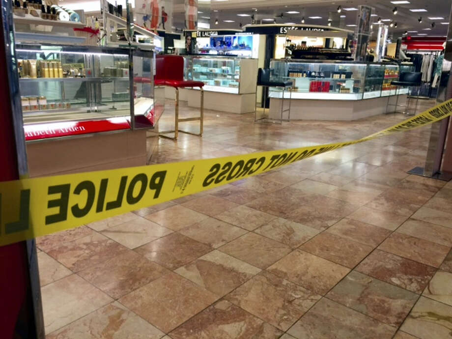 Crime scene tape is seen inside the Macy's at the Silver City Galleria mall in Taunton, Mass., Tuesday, May 10, 2016. Multiple people have been stabbed in separate attacks at the mall and a home in Massachusetts. Photo: Charles Winokoor — The Daily Gazette Via AP / The Daily Gazette