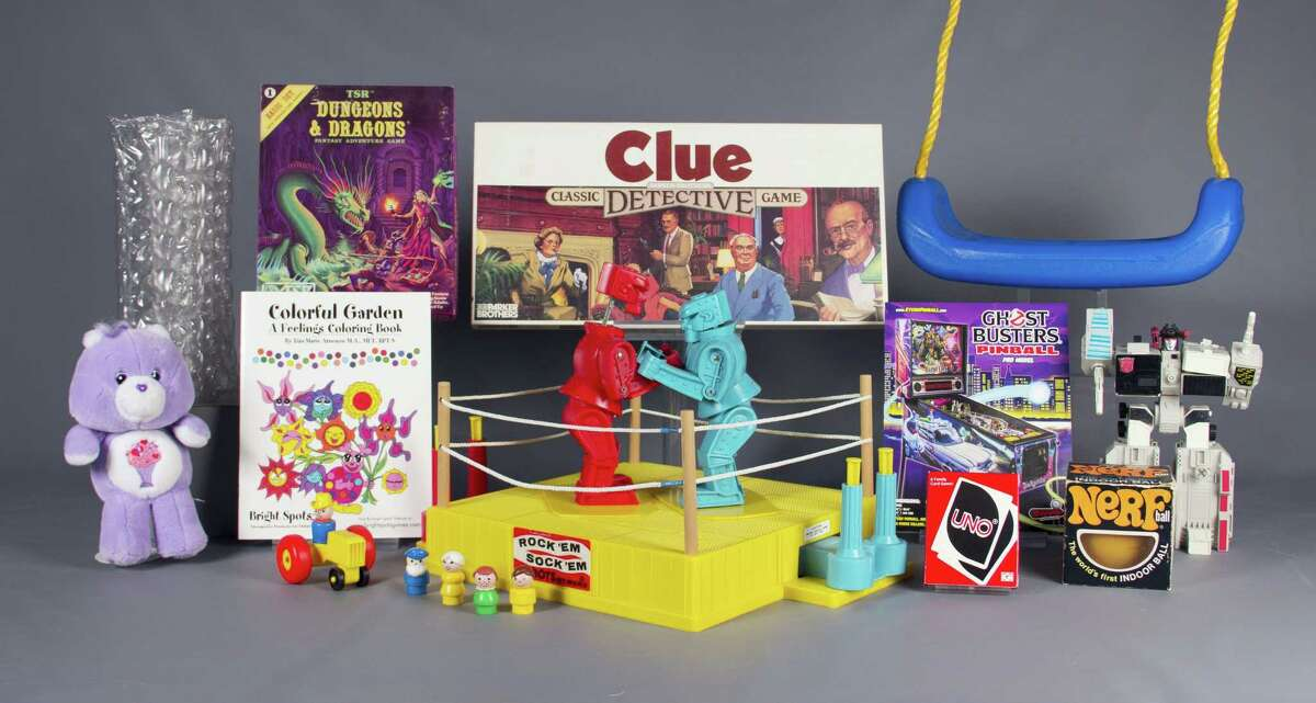 In this Aug. 10, 2016 photo provided by The Strong museum in Rochester, N.Y., are the 12 finalists for the class of 2016 for induction into the National Toy Hall of Fame: bubble wrap, Care Bears, Clue, coloring books, Dungeons & Dragons, Fisher-Price Little People, Nerf, pinball, Rock 'Em Sock 'Em Robots, swing, Transformers, and Uno. The winners will be chosen with input from a national selection committee and inducted on Nov. 10.