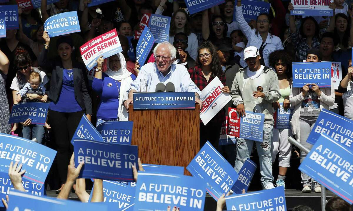 Supporters wave sign to show their support for Democratic presidential candidate, Sen. Bernie Sanders, I-Vt., during a campaign rally, Tuesday, May 10, 2016, in Stockton, Calif.
