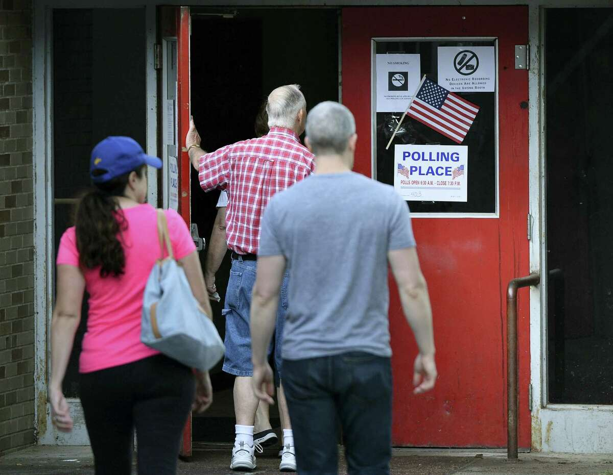 Voters enter their polling place at Stonewall Jackson Middle School on Tuesday, May 10, 2016 in Charleston, W.Va. West Virginians are casting ballots in a primary election with presidential contests, a Democratic showdown for governor and a winner-take-all state Supreme Court race.
