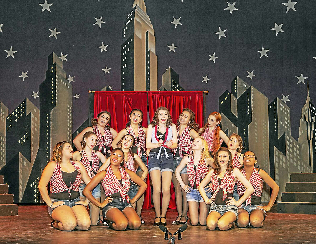 """Sandy Aldieri — Special to The Press Tiffany Berry (Adelaide) and her Hot Box Girls sing """"Bushel and a Peck"""" during dress rehearsal for Middletown High School's production of """"Guys and Dolls,"""" which begins its run this evening."""