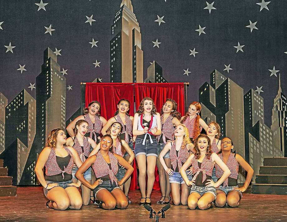 """Sandy Aldieri — Special to The Press  Tiffany Berry (Adelaide) and her Hot Box Girls sing """"Bushel and a Peck"""" during dress rehearsal for Middletown High School's production of """"Guys and Dolls,"""" which begins its run this evening. Photo: Journal Register Co."""