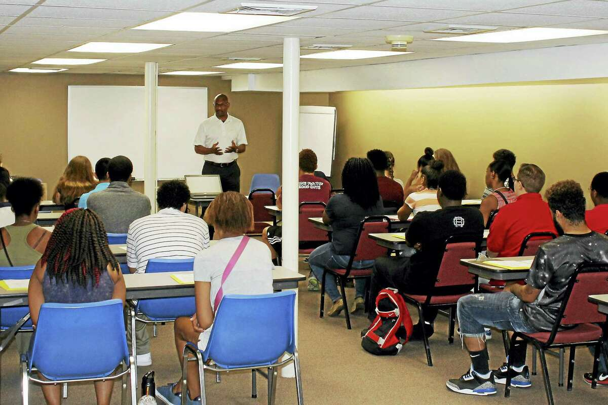 Middlesex County Chamber of Commerce Workforce Development Director Lorenzo Marshall leads an orientation for the 2016 Middletown Summer Youth Employment Program.